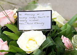 © Licensed to London News Pictures. 22/10/2011. Manchester, UK. Flowers left from Paul O'Grady at the funeral of former Coronation Street actress Betty Driver at St Ann's Church in Manchester. The actress lived to the age of 91. Photo credit : Joel Goodman/LNP