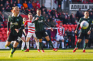 Alfie May of Doncaster Rovers (19) sees his shot deflect away from goal during the EFL Sky Bet League 1 match between Doncaster Rovers and Plymouth Argyle at the Keepmoat Stadium, Doncaster, England on 13 April 2019.