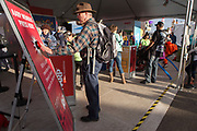 Randall Paul Smith pushes the member button at the AARP Block Party at the Albuquerque International Balloon Fiesta in Albuquerque New Mexico USA on Oct. 7th, 2018.