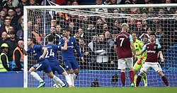 Chelsea's Cesar Azpilicueta (left) celebrates scoring his side's first goal of the game as West Ham United players look dejected