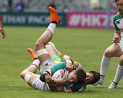 April 6, 2018 - Hong Kong, HONG KONG - Bryan Mollen (11) of Ireland being brought down by a Cook Islands player during the 2018 Hong Kong Rugby Sevens at Hong Kong Stadium in Hong Kong. (Credit Image: © David McIntyre via ZUMA Wire)