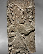 Close up of Hittite monumental relief sculpture ofa God probably holding lightning rods. Late Hittite Period - 900-700 BC. Adana Archaeology Museum, Turkey. Against a grey art background .<br /> <br /> If you prefer to buy from our ALAMY STOCK LIBRARY page at https://www.alamy.com/portfolio/paul-williams-funkystock/hittite-art-antiquities.html . Type - Adana - in LOWER SEARCH WITHIN GALLERY box. Refine search by adding background colour, place, museum etc.<br /> <br /> Visit our HITTITE PHOTO COLLECTIONS for more photos to download or buy as wall art prints https://funkystock.photoshelter.com/gallery-collection/The-Hittites-Art-Artefacts-Antiquities-Historic-Sites-Pictures-Images-of/C0000NUBSMhSc3Oo