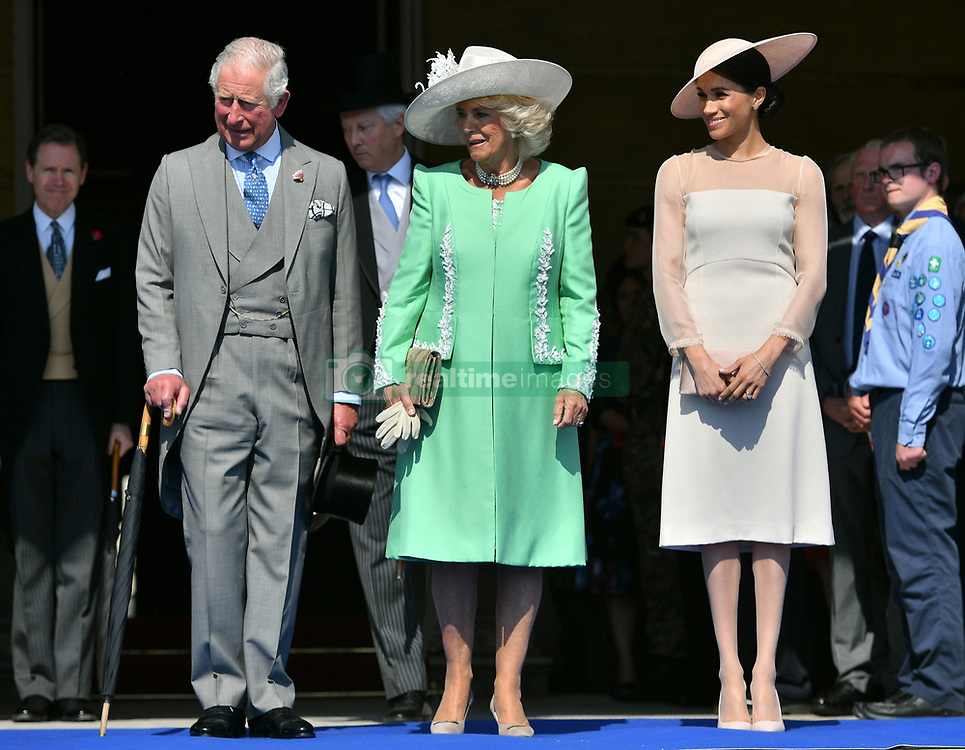The Prince of Wales, The Duchess of Cornwall, and The Duke and Duchess of Sussex attend The Prince of Wales' 70th Birthday Patronage Celebration in the Gardens of Buckingham Palace, London, UK, on the 22nd May 2018. 22 May 2018 Pictured: Prince Charles, Prince of Wales, Camilla, Duchess of Cornwall, Meghan, Duchess of Sussex. Photo credit: MEGA TheMegaAgency.com +1 888 505 6342