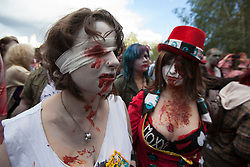 © licensed to London News Pictures. London, UK 13/10/2012. People with zombie costumes and make-ups posing in Southbank, London as more than 2,000 'zombies' celebrating World Zombie Day on 13/10/12 in London. Photo credit: Tolga Akmen/LNP