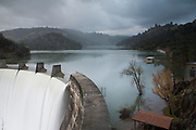 Englebright Dam, along the Yuba River, spills 8200 cubic feet per second over it's lip during early heavy storms in Northern California.  December 2010.