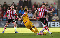 Lincoln City's Lee Frecklington vies for possession with Northampton Town's Shay Facey<br /> <br /> Photographer Chris Vaughan/CameraSport<br /> <br /> The EFL Sky Bet League Two - Lincoln City v Northampton Town - Saturday 9th February 2019 - Sincil Bank - Lincoln<br /> <br /> World Copyright © 2019 CameraSport. All rights reserved. 43 Linden Ave. Countesthorpe. Leicester. England. LE8 5PG - Tel: +44 (0) 116 277 4147 - admin@camerasport.com - www.camerasport.com