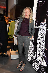PHOEBE COLLINGS-JAMES at the opening of the Tiger of Sweden Store, 210 Piccadilly, London on 3rd October 2013.