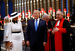 US President Donald Trump, accompanied by his wife Melania during a tour of Westminster Abbey in central London, on day one of his state visit to the UK.