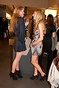 EMMA BASI; TANSY ASPINALL, Vogue: Fashion's Night Out: Armani. Bond st.  London. 8 September 2010.  -DO NOT ARCHIVE-© Copyright Photograph by Dafydd Jones. 248 Clapham Rd. London SW9 0PZ. Tel 0207 820 0771. www.dafjones.com.