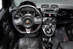 12 February 2015:  2015 FIAT 500 ABARTH CABRIO INTERIOR:  On exhibit at the 2015 Chicago Auto Show are the 2015 Fiat 500 Abarth and 500c Abarth (cabrio). For the first time, both hatchback and open-air versions will be available with a new six-speed automatic transmission, which is an option to the standard five-speed manual. The Fiat 500 Abarth models come equipped with the turbocharged and twin-intercooled 1.4-liter MultiAir engine that produces up to 160-horsepower. Abarth-designed side sills give an athletic profile, while 16-inch or optional 17-inch lightweight forged-aluminum wheels fill the flared wheel arches and provide ventilation for the performance brake system. Several upgrades to the 2+2 cockpit for 2015 include a seven-inch, high-definition color cluster display, Bluetooth streaming audio and a revamped center console. An Abarth-designed steering wheel features a thick rim, perforated leather and flat bottom to provide increased roominess. And, with a push of a button, the power-operated cloth-top retracts up to the rear spoiler during speeds up to a best-in-class 60 mph. Press the roof button again, and the roof will fold all the way open and tuck neatly behind the rear head restraints (up to 50 mph). Adding to the driving experience, the available Beats Audio studio-quality sound system includes six premium speakers, an eigh-inch dual-voice coil subwoofer with trunk-mounted enclosure and eight-channel 368-watt amplifier with Beats Audio digital sound processing algorithm. The 500 Abarth hatchback provides up to 26.8 cu. ft. of luggage room with rear seats folded, and there is 23.4 cu.ft. for the 500c Abarth. Included with each 2015 Fiat 500 Abarth and Abarth Cabrio is the opportunity for owners to attend a segment-exclusive driving experience at no additional charge. The Abarth Track Experience is an entire day of full-throttle training guided by professional instructors to ensure fun and top-level instruction in a safe and structured setting. Owner