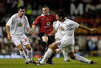 Fotball<br /> England 2005/2006<br /> Foto: SBI/Digitalsport<br /> NORWAY ONLY<br /> <br /> Manchester United v Debrecen VSC. UEFA Champions League Qualifier.<br /> 09/08/2005.<br /> <br /> Manchester United's Wayne Rooney (C) can find no way through the Debreceni defence.