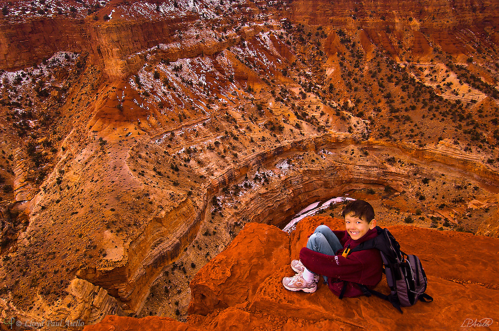 LB (age 7) sits overlooking the Goosenecks at Capitol Reef National Park in Utah.