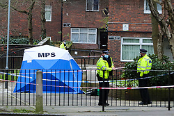 © Licensed to London News Pictures. 26/01/2021. London, UK. Police officers guard a police tent at a crime scene on Holland Walk in Islington, north London after a fatal stabbing of a teenage boy. Police were called to Holland Walk on Monday 25 January at approximately 17:30GMT to a report of a stabbing. Officers attended with London Ambulance Service and helicopter emergency medical service (HEMS), and found a teenage boy suffering from a stab injury. Despite efforts by emergency services he was sadly pronounced dead at the scene a short while later. Photo credit: Dinendra Haria/LNP