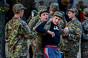 Youngsters participating to the ultra-nationalistic Azovets children's camp are wrestling each other during a break, on the banks of the Dnieper river, in Kiev, Ukraine's capital.