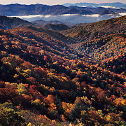 Brilliant autumn colors paint the mountain sides and the trees in Great Smoky Mountains, NC.