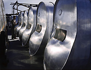 Bomb bay fuel tanks for long flights of B-25 bombers awaiting assembly at the North American Aviation Inc. assembly  Plant, Inglewood, California,  USA, October 1942. World War II Aviation