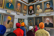 Sikhs studying the portraits in the museum at Amritsar's Golden Temple.