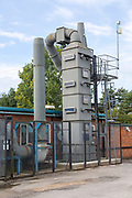 Exhaust gas air purification tower at small specialist steel firm, Calne, England, UK