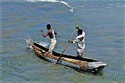 Tow Men In Dugout Canoe