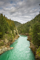 The Smith River in northern California as it carves its way to the sea east of Redwood National Park just outside of the town of Smith River California.
