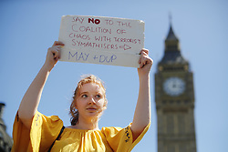 June 10, 2017 - London, London, UK - London, UK. People protest against Prime Minister Theresa May's new government and a coalition with the DUP in Parliament Square, London on Saturday, 10 June 2017 as the UK snap general election leads to a hung parliament. (Credit Image: © Tolga Akmen/London News Pictures via ZUMA Wire)
