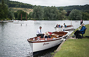 Henley on Thames, United Kingdom. 2016 Henley Masters' Regatta. Henley Reach. England. on Saturday  09/07/2016    [Mandatory Credit/ © Peter SPURRIER]<br /> <br /> Umpires Launch, Driver and Umpire in the marshalling area Rowing, Henley Reach, Henley Masters' Regatta.<br /> <br /> <br /> General View,  Henley Reach, venue, for the 2016 Henley Masters Regatta.<br /> <br /> NIKON CORPORATION  NIKON D810  f1.6  1/8000sec  85mm  12.0MB