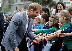 The Duke of Sussex greets children during a visit to Albert Park Primary School in Melbourne, on the third day of the royal couple's visit to Australia.
