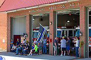 Men and boys congregate at the front of the Mifflinburg Hose Company firehouse during the Mifflinburg Pride Event.