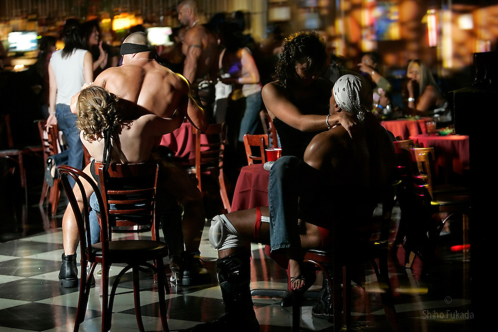 Male strippers perform in New York.