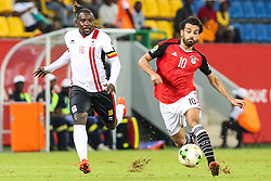 PORT-GENTIL, GABON - JANUARY 21: Mohamed Salah (10) of Egypt in action against Hassan Wasswa (16) of Uganda during the African Cup of Nations 2017, Group D football match between Egypt and Uganda at Port-Gentil Stadium in Port-Gentil, Gabon on January 21, 2017. Fared Kotb / Anadolu Agency    BRAA20170121_824 Port-Gentil Gabon