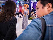 24 JULY 2013 - BANGKOK, THAILAND:  A hair model gives a TV interview at the Hairworld Festival in Siam Paragon, an upscale shopping mall in Bangkok, Thailand.        PHOTO BY JACK KURTZ