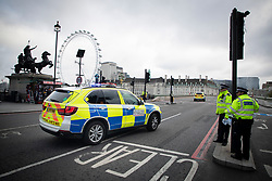 © Licensed to London News Pictures. 13/10/2020. London, UK. A Police car drives through a cordon on Westminster Bridge following a security alert at St Thomas' Hospital. Photo credit: George Cracknell Wright/LNP