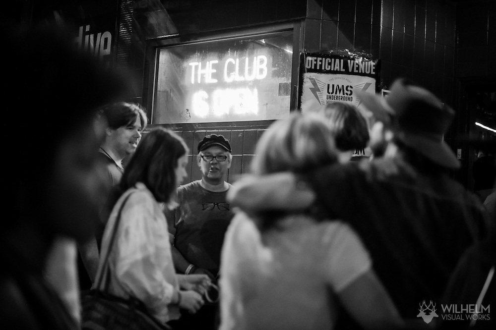 Attendees queue outside of the Hi-Dive during the Underground Music Showcase in Denver, CO, USA, on 23 July, 2015.