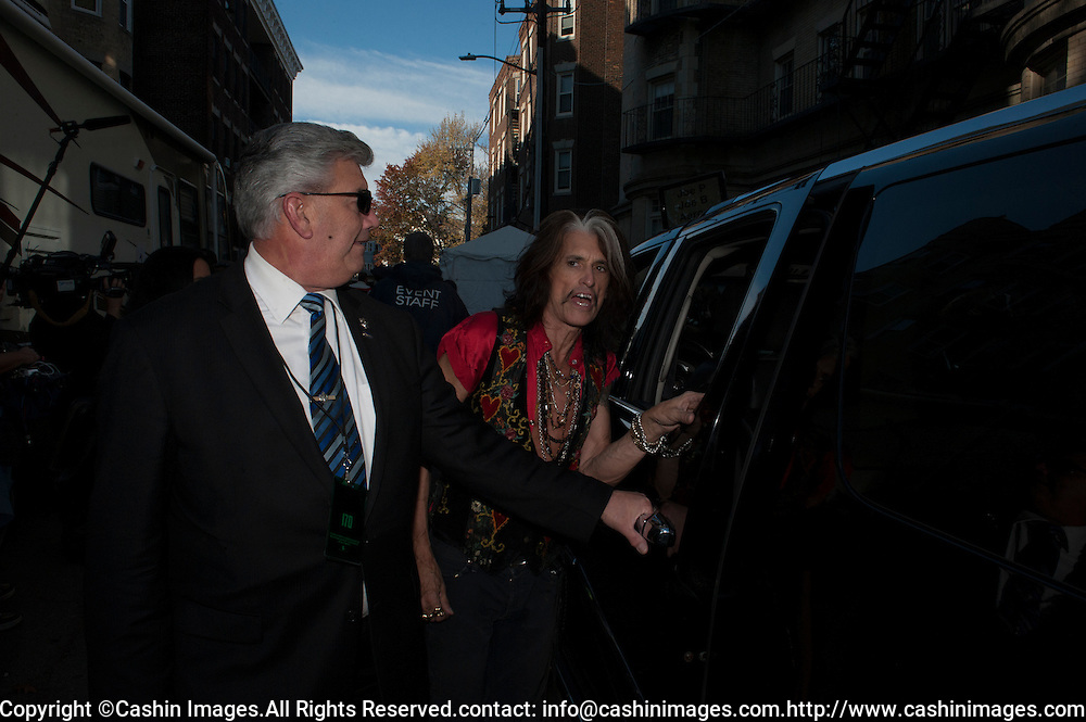 05 November 2012:  Aerosmith's Joe gets into a limo after a free concert in Boston's Allston neighborhood in front of the apartment building, 1325 Commonwealth Ave, which was the band's home in the early 1970's.  Boston, MA. ***Editorial Use Only*****