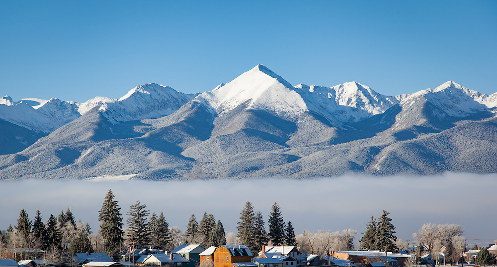 An October snow dusting is revealed as fog lifts from Westcliffe and the Wet Valley.