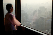 "Woman in traditional Korean clothes watching the Seoul skyline at ""The 63 Building"", officially the 63 City, at a skyscraper on Yeouido island, overlooking the Han River in Seoul, South Korea. At 249 meters (817 ft) high, it was the tallest building outside North America when completed in 1985, but as of 2010 is no longer in the top 100. It was South Korea's tallest building until Hyperion Tower surpassed it in 2003 and remained South Korea's tallest commercial building until the Northeast Asia Trade Tower was topped-out in 2009."