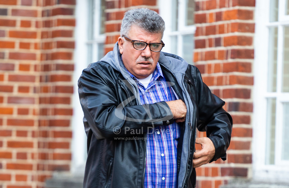 Mr Hatam Awad Hamad leaves Uxbridge Magistrates Court after pleading guilty to assaulting an American Television executive on a flight to London and being sentenced posix weeks in prison suspended for one year and made to pay £800. Uxbridge, October 12 2018.