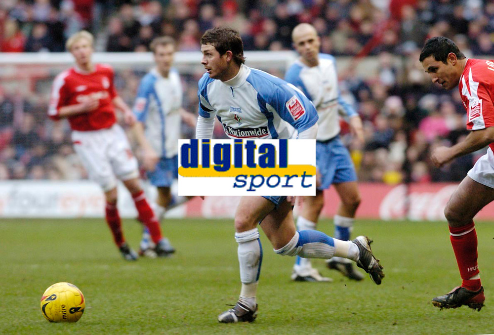 Photo: Leigh Quinnell.<br /> Nottingham Forest v Swindon Town. Coca Cola League 1. 25/02/2006. Swindons Jamie Cureton can't find a way through the Nottingham Forest defence.