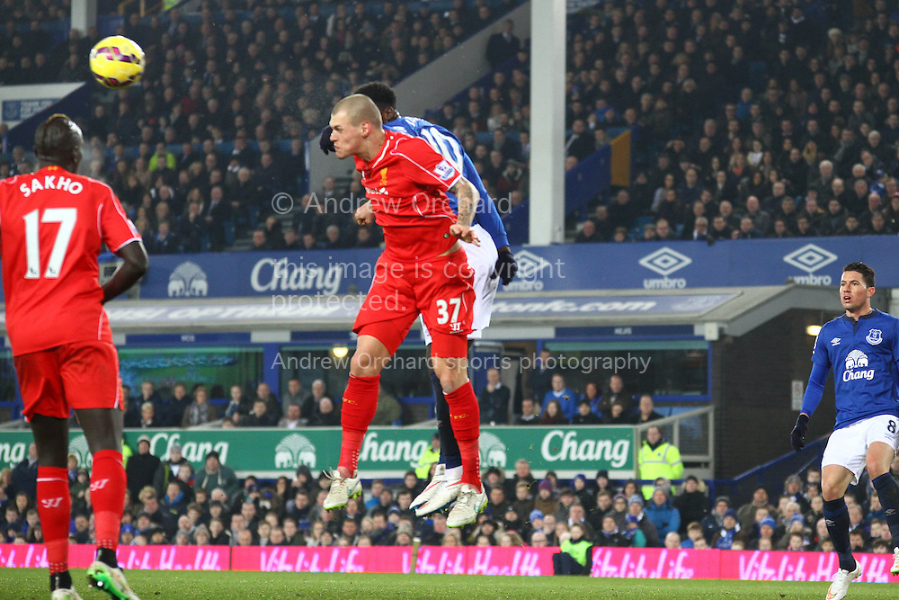Martin Skrtel of Liverpool wins the header against Romelu Lukaku of Everton. Barclays Premier league match, Everton v Liverpool at Goodison Park in Liverpool, Merseyside on Saturday 7th February 2015<br /> pic by Chris Stading, Andrew Orchard sports photography.