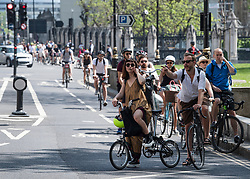 © Licensed to London News Pictures. 09/05/2020. London, UK. Cyclists gather at traffic lights on Parliament Square in Westminster, London, during lockdown. The government is set to announce measures to ease lockdown, which was introduced to fight the spread of the COVID-19 strain of coronavirus. Photo credit: Ben Cawthra/LNP