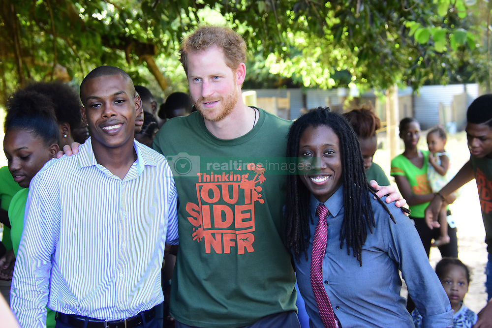 Prince Harry nuzzles a horse while visiting the Nature Fun Ranch in St. Andrew in Barbados.<br /> The ranch helps teens who have troubled lives sort out their problems while caring for the horses, growing vegetables and managing fish hatcheries. The ranch allows young people to speak freely with one another about important topics, including HIV/AIDS, providing them with a positive focus to guide their lives in the right direction, in a rural setting while tending to horses, working vegetable patches, or managing fish hatcheries.  While on his royal tour of the Caribbean, Prince Harry got a chance to meet Rihanna in a not so hopeless place. The royal and the singer were both in Barbados for the celebration of 50 years of independence. And of course, they hung with each other.<br /> 01 Dec 2016<br /> Pictured: Prince Harry.<br /> Photo credit: MEGA<br /> <br /> TheMegaAgency.com<br /> +1 888 505 6342