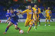 Oldham Athletic midfielder, on loan from MK Dons, Giorgio Rasulo  and Mansfield Town midfielder Jamie McGuire  during the The FA Cup first round match between Oldham Athletic and Mansfield Town at Boundary Park, Oldham, England on 17 November 2015. Photo by Simon Davies.