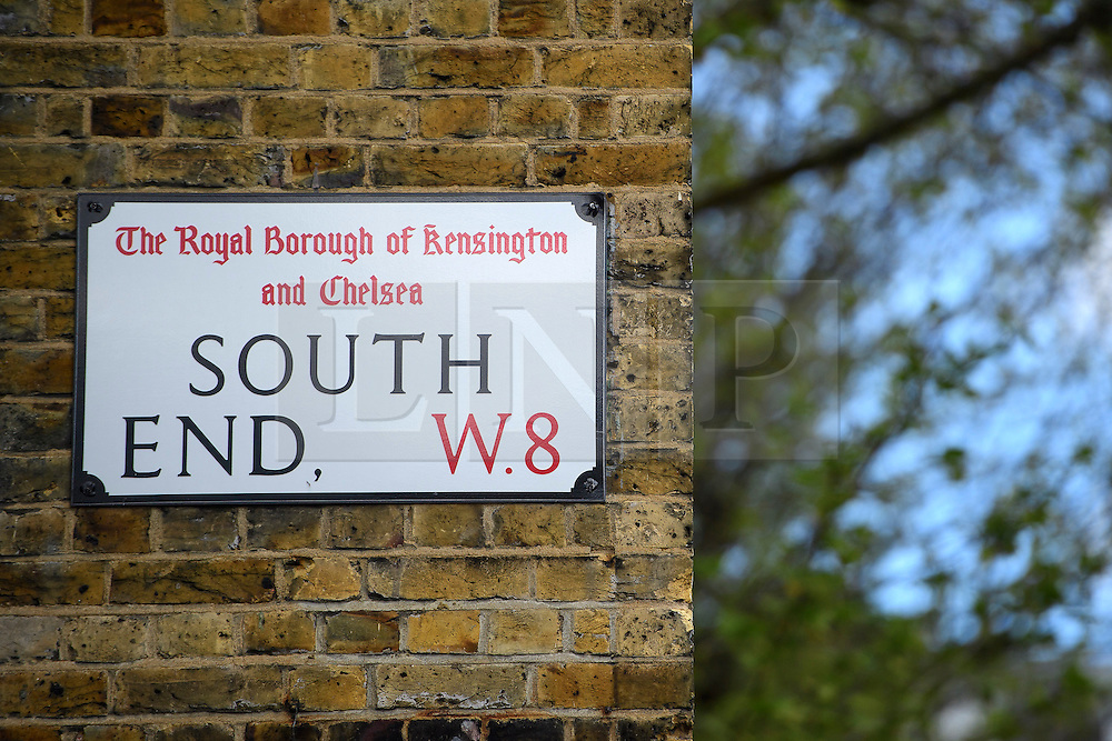 © London News Pictures. 27/04/2016. A road sign for South End in Kensington, the location of a house painted with red and white stripes in west London which is currently being demolished and then rebuilt. The candy stripes were originally painted on to the multi-million pound house following a dispute in which  neighbours objected to plans to demolish the building and replace it with a new house and two-storey basement. Photo credit: Ben Cawthra/LNP