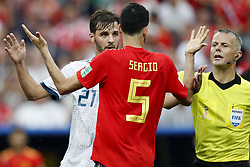 (L-R) Aleksandr Erokhin of Russia, Sergio Busquets of Spain, referee Bjorn Kuipers during the 2018 FIFA World Cup Russia round of 16 match between Spain and Russia at the Luzhniki Stadium on July 01, 2018 in Moscow, Russia
