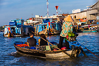 Boats on the Hau River, a branch of the Mekong River, Can Tho, Mekong Delta, Vietnam.