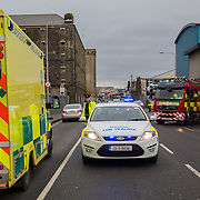 14.11.2016          <br /> Major winter safety and wellbeing campaign launched by Limericks Public Services. <br /> <br /> Garda Aidan O'Gorman, Limerick Traffic Corps hand out High Visability Jackets and information leaflets during a combined checkpoint between Limerick City and County Council, the HSE and An Garda Siochana on the Dock Road Limerick. Picture: Alan Place