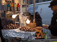 Warm chestnuts on a damp wintry day; Fifth Avenue, New York City.