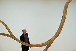 © Licensed to London News Pictures.03/02/2014. London, UK. A museum employee looks at artwork of Richard Deacon in Tate Britain. The museum presents a major exhibition of the work of Turner Prize winner Richard Deacon, a leading British sculptor. Photo credit : Peter Kollanyi/LNP
