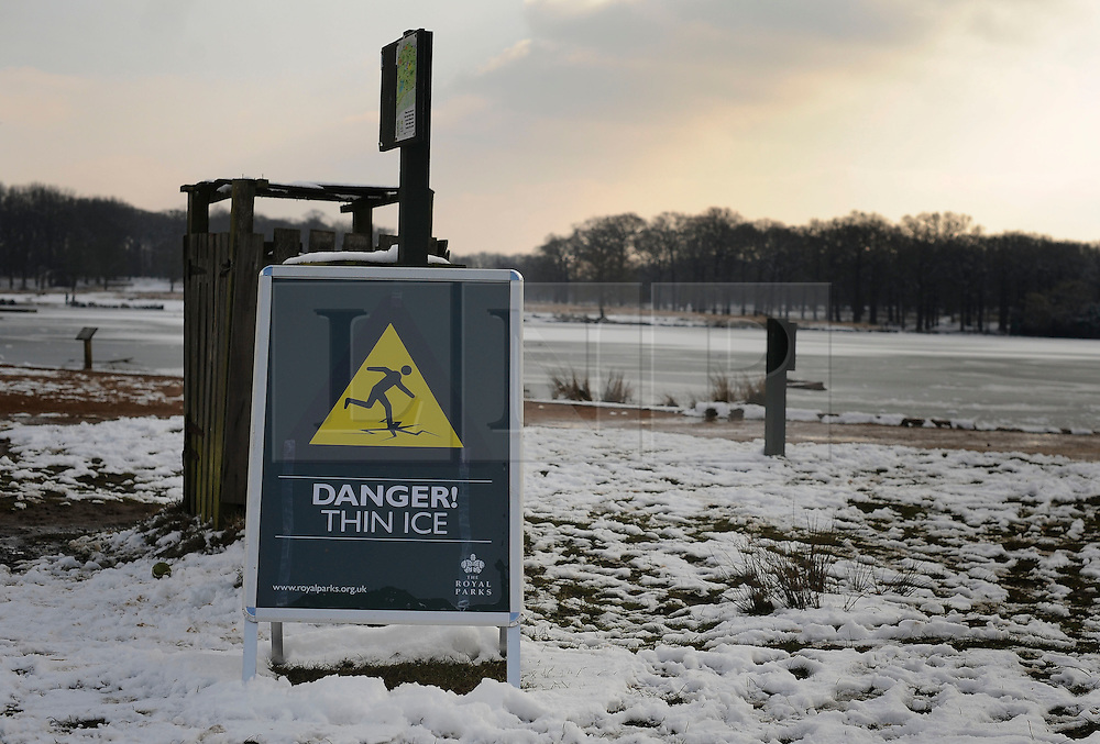 © Licensed to London News Pictures. 10/02/2012, Richmond, UK. A sign reading 'Danger, thin ice' People enjoy the snow in Richmond Park in West London today 10 February 2012. The cold weather across the UK is set to continue over the weekend.  Photo credit : Stephen Simpson/LNP
