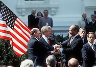 A 27MG IMAGE OF:..Jimmy Carter, Menachem Begin and Anwar Sadat in a three way handshake  on the North lawn of the White House during the Middle East Peace Treaty signing in March 26, 1979..Photo by Dennis Brack
